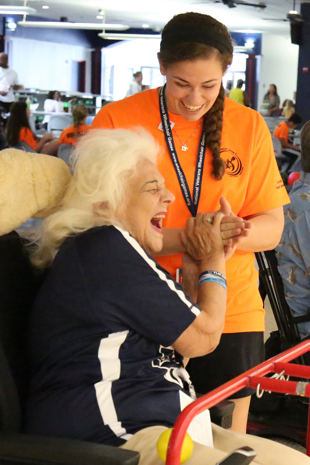 Student volunteer assists Veteran at National Veterans Wheelchair Games